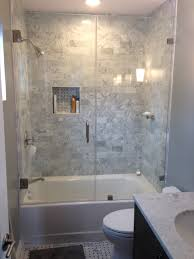 White Gray Bathroom Ideas - rectangular white fiberglass bathtub with glass partition combined