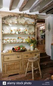 Cottage Kitchen by Vintage China On Old Pine Dresser In Cottage Kitchen Stock Photo