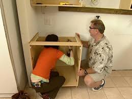 how to build a base for cabinets to sit on how to install wall and base kitchen cabinets how tos diy