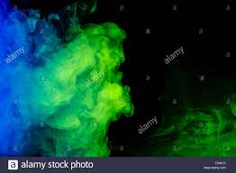 green halloween background abstract art colour blue green smoke hookah on a black background