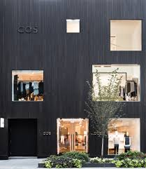 home design stores in toronto blackened cedar planks cover the facade of cos toronto store