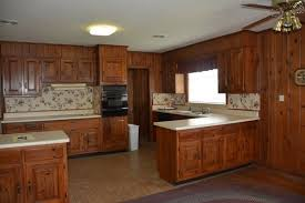 1951 kitchen with cherry cabinets and wood paneling what to do