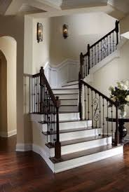 Designing Stairs Front Foyer Needs A Better Picture Display On The Stairs Wall