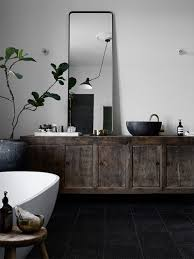 decordots bathroom with black textured floor tiles old vintage