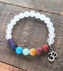 crystal quartz bracelet images Matte gemstone chakra bracelet with crystal quartz and om charm jpg