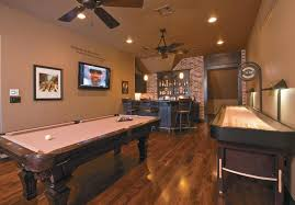 interior striking ceiling fan with lighting over pool table and
