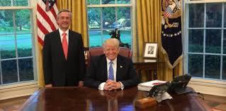 donald trump poses in oval office with pastor who claims