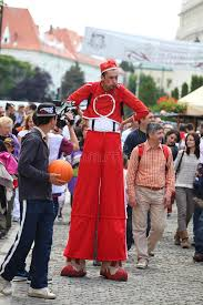clown stilts undecided clown on stilts editorial stock image image of