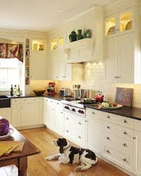 antique white kitchen traditional with cherry island drop