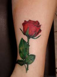amazing traditional anchor rose tattoo on biceps real photo
