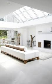 White Home Interior Design by The Design Chaser Pitched Roofing Wooden Beams