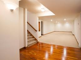 creative design hardwood floor on concrete basement installing