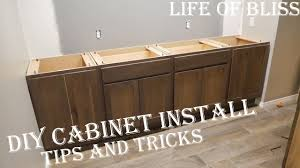 best way to install base cabinets diy how to install base kitchen cabinets basement bar build