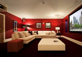this bright red media room has a light cream sectional sofa and an