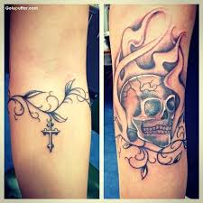 arm decorated traditional flower vine armband and cross skull