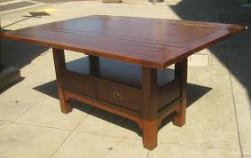 large old drop leaf kitchen table with double drawer storage for