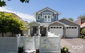 hamptons style facade a custom designed home by orbit homes