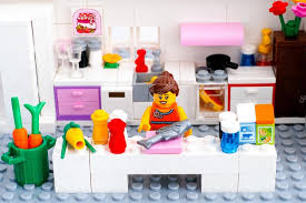 lego kitchen lego woman cooking fish in domestic kitchen stock editorial photo