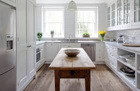 new england kitchen in spring subway tiles reflect clean white