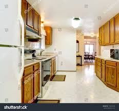 white kitchen cabinets with tile floor bright kitchen wood cabinets tile floor stock photo edit