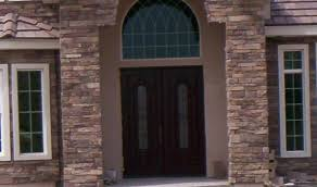 exterior design stone wall with trustile doors and white frame