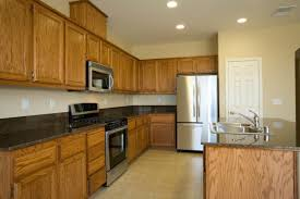 what color backsplash with honey oak cabinets paint color advice for a kitchen with oak cabinets thriftyfun