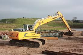 liebherr crawler excavator r 926 in action during coastal repair