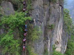children in china who climb 2 500 foot cliff to get to may