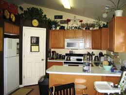 top of kitchen cabinet decorating ideas decorating above kitchen cabinets tuscan style 87 in above