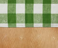 Gingham Kitchen by Wooden Kitchen Table With Green Gingham Tablecloth Stock Photo