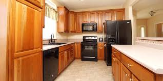 how to clean cherry wood cabinets this kitchen is unrecognizable after a makeover for only 95