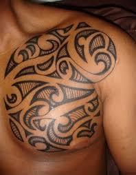 stylish men tribal earth tattoo on upper back tattoos earthy