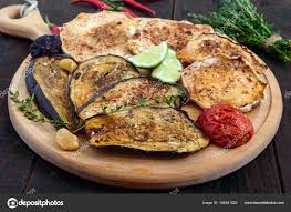 cuisine patisson baked vegetables eggplant patisson tomatoes on a wooden