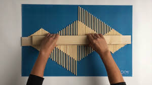 diy an aztec style wooden stick wall