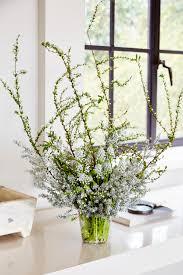 white flower arrangements lines a silver and white arrangement flower magazine