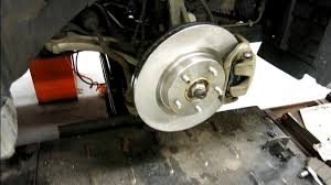 2016 nissan maxima youtube how to replace the front rotors and brake pads on 2007 2012 nissan