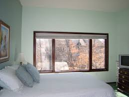 interior bedroom wide brown stained teak wood frame glass window