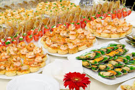 a lot of cold snacks on buffet table catering stock photo