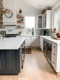 kitchen with black island and white cabinets farmhouse kitchen reveal tour my parents kitchen the