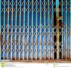 Metal Door Designs Old Rusty Blue Folding Metal Door Stock Photo Image 66393035