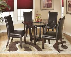 charrell round dining room table u0026 4 medium brown uph side chairs