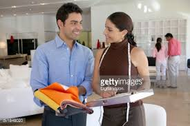 customer and shop assistant in a home interior shop choosing from