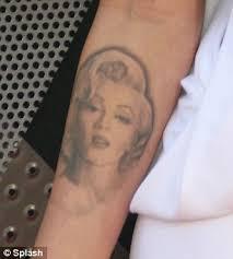 megan fox on why she u0027s removing her tattoo of tragic marilyn