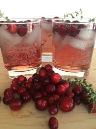 thanksgiving cocktail with cranberries and thyme the daily hostess