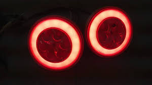 led round trailer brake light with red lens and clear center arafen