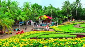 Nong Nooch Tropical Botanical Garden by Peoples Walks In Nong Nooch Tropical Garden In Thailand Royalty