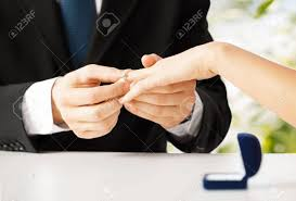 Wedding Ring Hand by Picture Of Man Putting Wedding Ring On Woman Hand Stock Photo