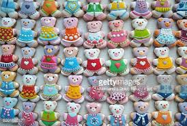 directly above shot of colorful teddy bear shape christmas cookies