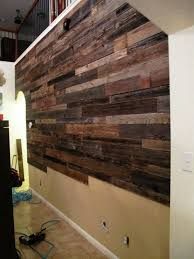 reclaimed wood wall ideas these guys used reclaimed wood to make a beautiful accent wall