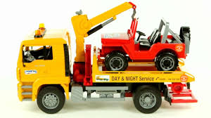 man tga breakdown tow truck with cross country vehicle bruder